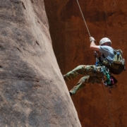 Man abseiling on rock face