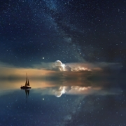 Sailboat becalmed at night