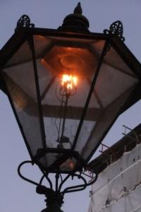 Flame in old style burner lamp in London street