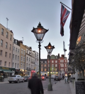 Two flame lamp gas streetlights burning in London