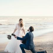 Man serenading woman on beach